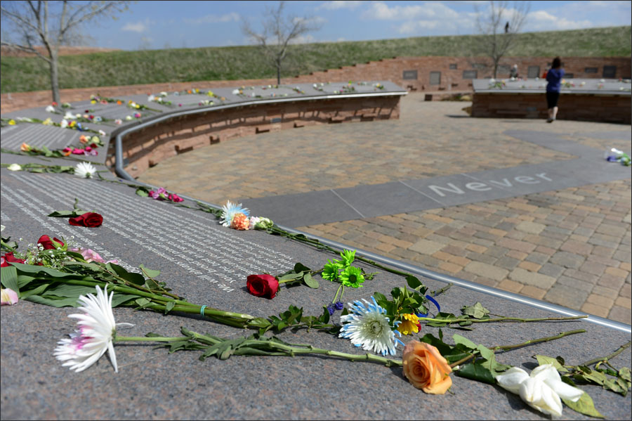 LITTLETON, CO - APRIL 20: Visitors bring flowers and spend time at the Columbine Memorial on Monday, April 20, 2015. Today marks the 16th anniversary of the deadly shooting at Columbine High School which left 12 students and one teacher dead. The school was closed for the day, as it has been every year on this day since the shooting occurred in 1999. (Photo by Kathryn Scott Osler/The Denver Post)